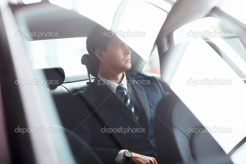 Mature businessman in the car — Stock Photo #13432981