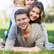 Smiling family — Stock Photo #14151624