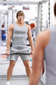 Man with a barbell — Stock Photo