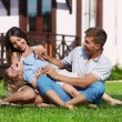 Playing on a lawn — Stockfoto
