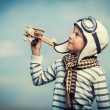 Boy with wooden plane — Stock Photo
