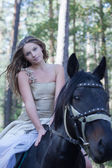 Young woman horseback riding — Stock Photo