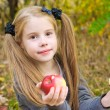 Stock Photo: Little girl eating apple