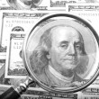 Magnifier with money closeup — Stock Photo #1870450