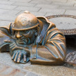 Bronze sculpture called man at work — Stock Photo