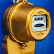 Golden retro electric meter — Stock Photo