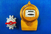 Golden electric meter with toggle switch — Stock Photo