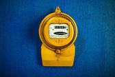 Golden retro electric meter — Stock Photo