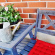 Stock Photo: Watering cand flower pot on table