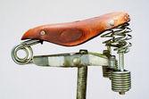 Old-fashioned vintage leather bike saddle — Stock Photo