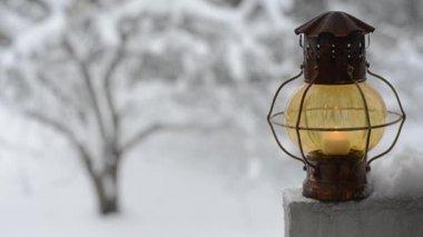 Vintage xmas lantern against the winter garden — Stock Video