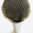 Stock Photo: Vintage microphone over white