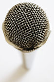 Vintage microphone over white — Stock Photo