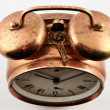 Vintage copper alarm clock — Stock Photo