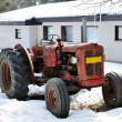 Old red tractor on a farm — Stock Photo #23638341