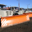 Row of new snow plows — Stock Photo