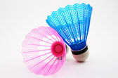 Pink and blue badminton shuttlecocks on a white — Stock Photo