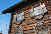 Facade of the traditional russian wooden house — Stock Photo