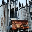 Stock Photo: Old rusty transformer substation