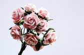 Artificial bouquet on a gray background — Stock Photo