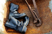 Old vintage leather boots and rusty wrench — Stock Photo