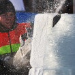 Stock Photo: PETROZAVODSK, RUSSIA, FEBRUARY 15: artist is cutting iceblock w