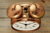 Old-fashioned vintage copper alarm clock — Stock fotografie