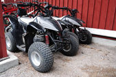 Two ATVs outdoor near the house — Stock Photo