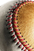 Dirty baseball, white and brown on a gray background — Fotografia Stock