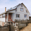 Typical new farmhouse in northern Russia — Stock Photo