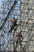 Workers assemble metal construction  — Foto Stock