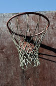 Closeup of old basketball backboard and hoop outdoor — Stock Photo