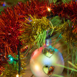 Beautiful Christmas ball on the tree - Defocused - Stock Photo
