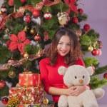 Girl near christmas tree — Stock Photo