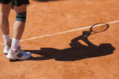 Shadow of a tennis player on court — Stock Photo