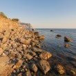 Beach between rocks and sea. Black Sea, Ukraine. - Stockfoto