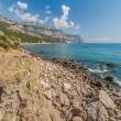 Beach between rocks and sea. Black Sea, Ukraine. — Stock Photo