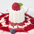 Stock Photo: Panacottdessert with ripe raspberries,