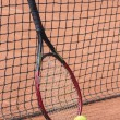 Stock Photo: Tennis racket and balls on clay court