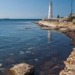 Lighthouse, sea and rock, blue sky. Crimea. — Stock Photo #29625123