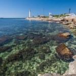 Lighthouse, sea and rock, blue sky. Crimea. — Stock Photo #29630687