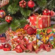 Christmas tree branch with gift — Stock Photo #35260611