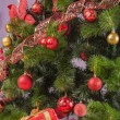 Christmas tree branch with gift — Stockfoto #35260903