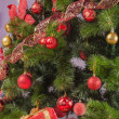 Christmas tree branch with gift — Foto de stock #35260903