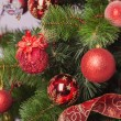 Christmas tree branch with gift — Stock Photo #35262297