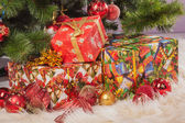 Christmas tree branch with a gift — Stock Photo