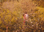 Portrait of young couple in park — Stock Photo