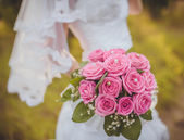 Wedding bouquet in hands of the brid — Stock Photo