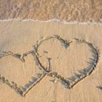 Heart on wet golden beach sand — Stock Photo #44851373