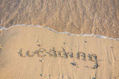 Wedding written in the Sand — Stock Photo
